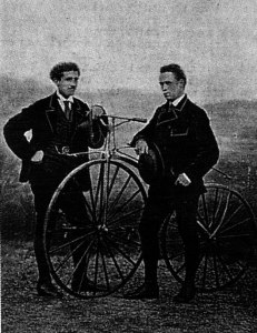 James Moore (right) with his Suriray bicycle. and runner-up Jean-Eugène-André Castera (left).